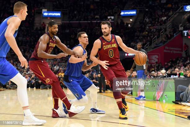 Kristaps Porzingis and Dwight Powell of the Dallas Mavericks try to guard Tristan Thompson ad Kevin Love of the Cleveland Cavaliers during the second...