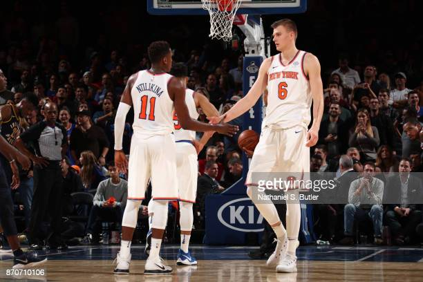 Kristaps Porzingis and Frank Ntilikina of the New York Knicks high five during the game against the Indiana Pacers on November 5 2017 at Madison...
