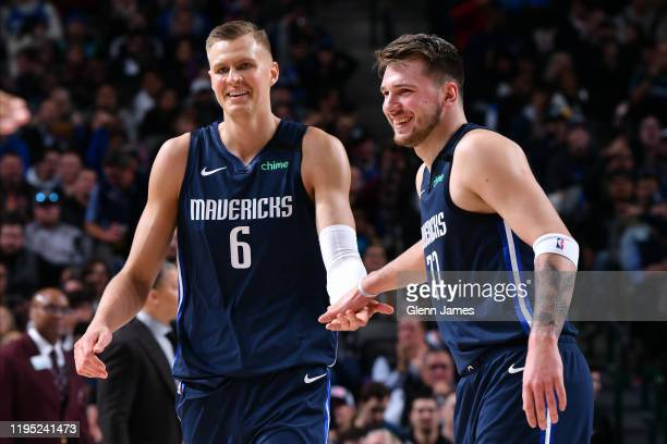 Kristaps Porzingis and Luka Doncic of the Dallas Mavericks high five each other during the game against the LA Clippers on January 21 2020 at the...