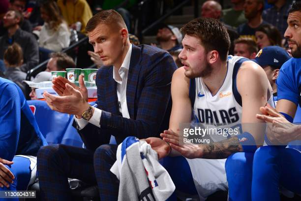 Kristaps Porzingis and Luka Doncic of the Dallas Mavericks react to a play during the game against the Denver Nuggets on March 14 2019 at the Pepsi...
