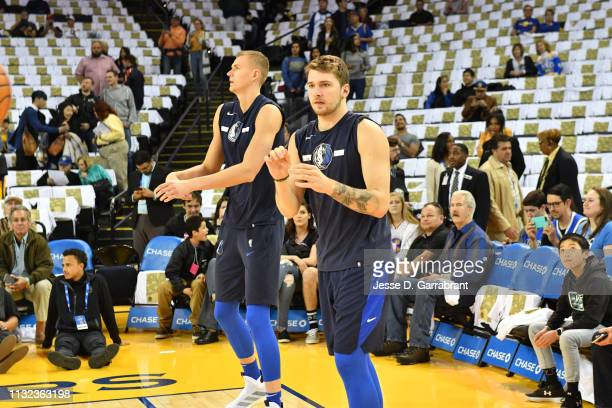 Kristaps Porzingis and Luka Doncic of the Dallas Mavericks warm up prior to a game against the Golden State Warriors on March 22 2019 at ORACLE Arena...