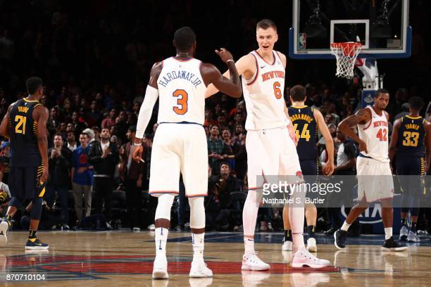 Kristaps Porzingis and Tim Hardaway Jr #3 of the New York Knicks high five during the game against the Indiana Pacers on November 5 2017 at Madison...