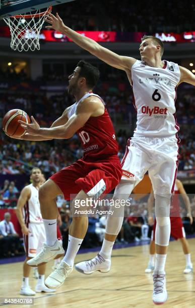 Kristaps Porzingis of Latvia in action against Melih Mahmutoglu of Turkey during the FIBA Eurobasket 2017 Group D Men's basketball match between...