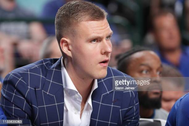 Kristaps Porzingis of the Dallas Mavericks looks on during the game against the Sacramento Kings on March 26 2019 at the American Airlines Center in...