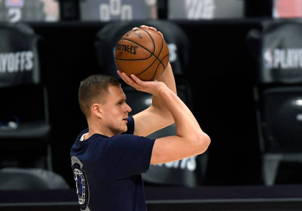 Kristaps Porzingis of the Dallas Mavericks shoots during pre game warm ups during Game Seven of the Western Conference first round series against the...