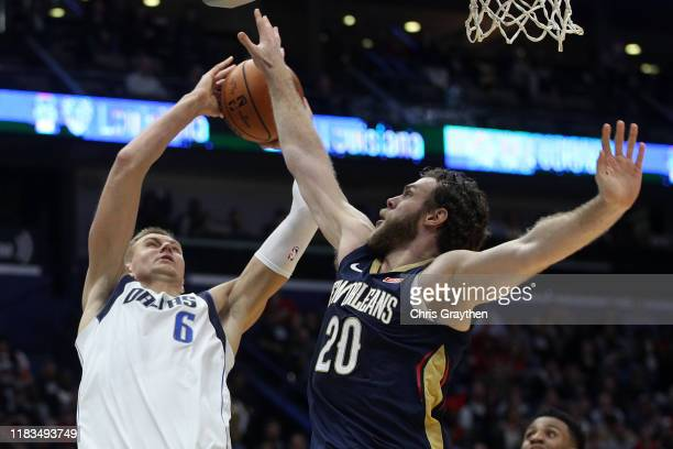 Kristaps Porzingis of the Dallas Mavericks shoots the ball over Nicolo Melli of the New Orleans Pelicans at Smoothie King Center on October 25 2019...