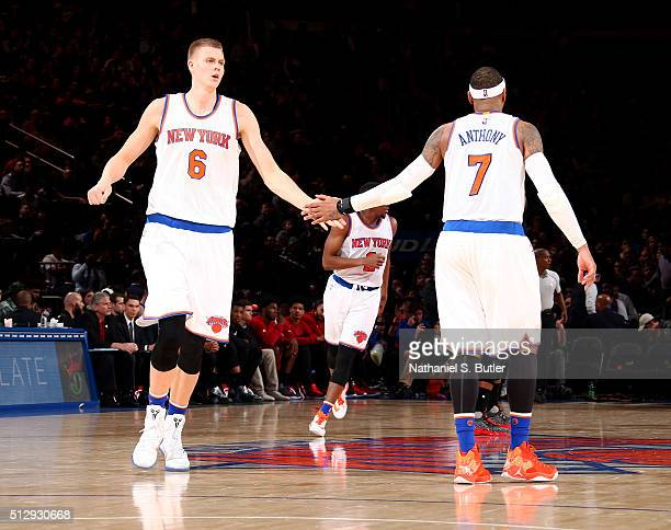 Kristaps Porzingis of the New York Knicks and Carmelo Anthony of the New York Knicks celebrate during the game against the Miami Heat on February 28...