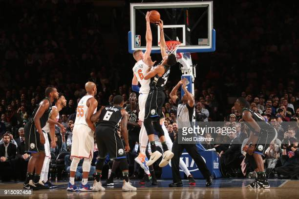 Kristaps Porzingis of the New York Knicks and Giannis Antetokounmpo of the Milwaukee Bucks reach for the tipoff during the game on February 6 2018 at...