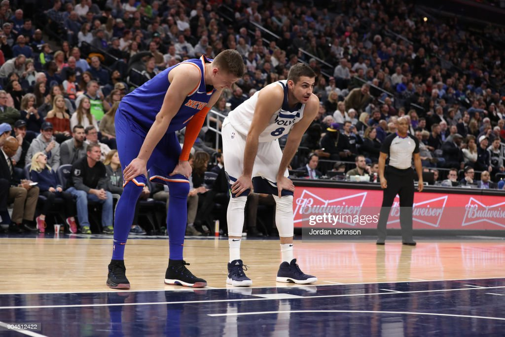 Kristaps Porzingis #6 of the New York Knicks and Nemanja Bjelica #8 of the Minnesota Timberwolves stand on the court during the game on January 12, 2018 at Target Center in Minneapolis, Minnesota.