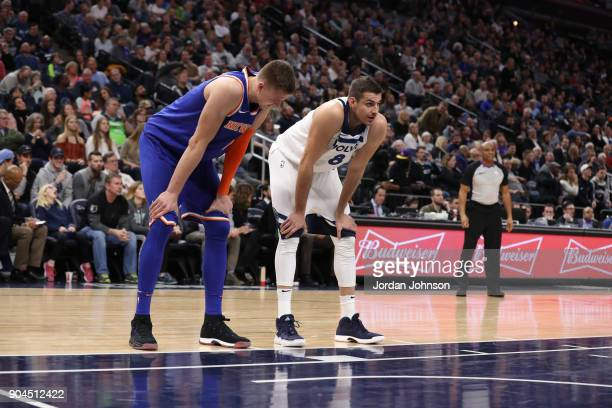 Kristaps Porzingis of the New York Knicks and Nemanja Bjelica of the Minnesota Timberwolves stand on the court during the game on January 12 2018 at...