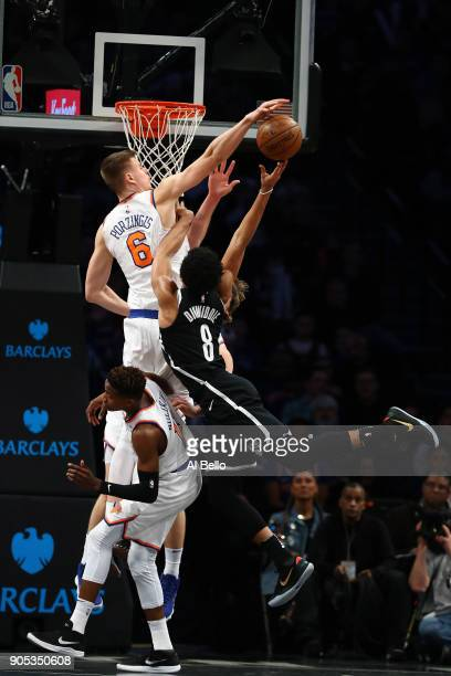 Kristaps Porzingis of the New York Knicks attempts to block a shot against Spencer Dinwiddie of the Brooklyn Nets during their game at the Barclays...