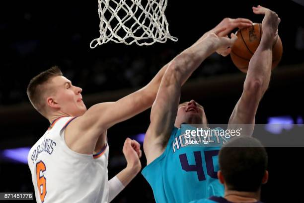 Kristaps Porzingis of the New York Knicks blocks Cody Zeller of the Charlotte Hornets in the first half during their game at Madison Square Garden on...