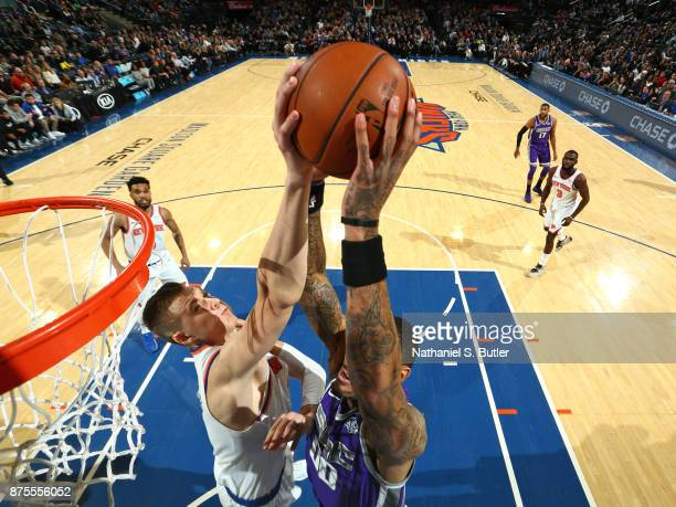Kristaps Porzingis of the New York Knicks blocks the shot by Willie CauleyStein of the Sacramento Kings on November 11 2017 at Madison Square Garden...
