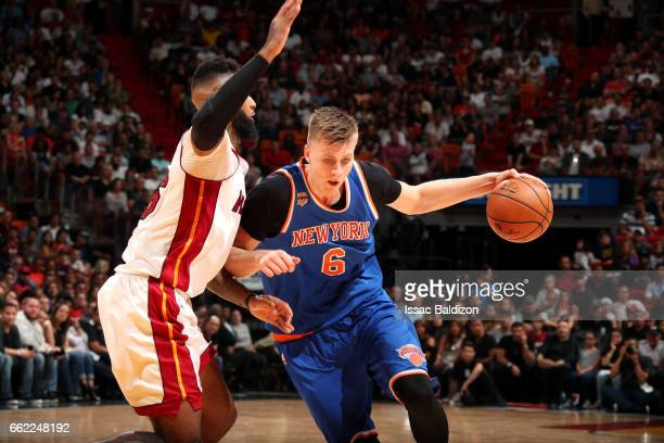 Kristaps Porzingis of the New York Knicks brings the ball up court during the game against the Miami Heat on March 31 2017 at AmericanAirlines Arena...