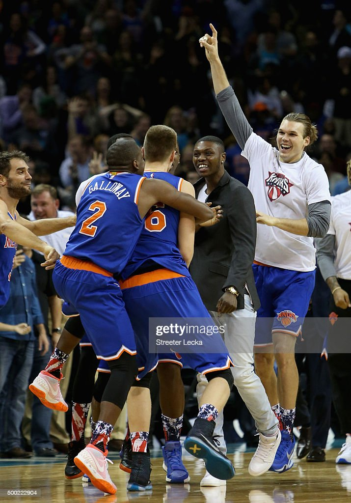 Kristaps Porzingis #6 of the New York Knicks celebrates with teammates after a shot at the end of the game which was overturned giving the Charlotte Hornets a 95-93 victory at Time Warner Cable Arena on November 11, 2015 in Charlotte, North Carolina.