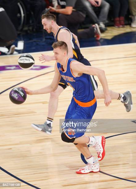 Kristaps Porzingis of the New York Knicks competes against Gordon Hayward of the Utah Jazz in the 2017 Taco Bell Skills Challenge at Smoothie King...
