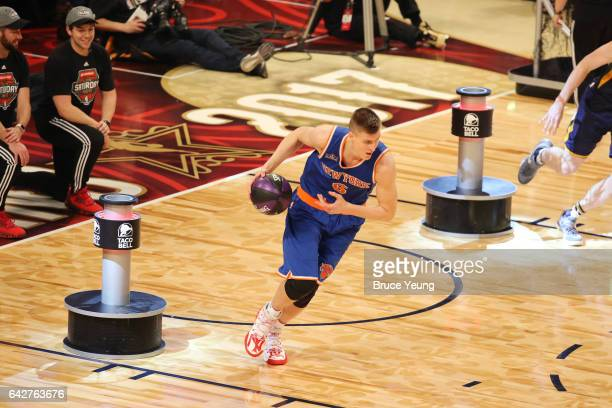 Kristaps Porzingis of the New York Knicks drives to the basket during the Taco Bell Skills Challenge during State Farm AllStar Saturday Night as part...