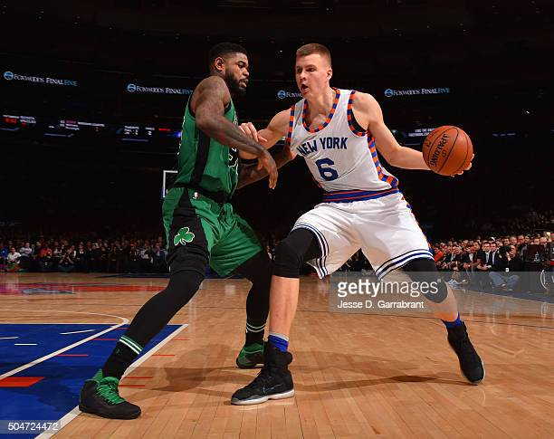 Kristaps Porzingis of the New York Knicks drives to the basket against the Boston Celtics at Madison Square Garden on January 12 2016 in New YorkNew...