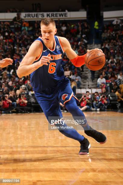 Kristaps Porzingis of the New York Knicks drives to the basket against the New Orleans Pelicans on December 30 2017 at the Smoothie King Center in...