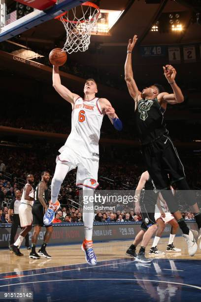 Kristaps Porzingis of the New York Knicks drives to the basket against the Milwaukee Bucks on February 6 2018 at Madison Square Garden in New York NY...
