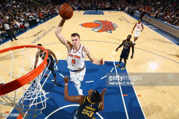 Kristaps Porzingis of the New York Knicks dunks against the Indiana Pacers on November 5 2017 at Madison Square Garden in New York City New York NOTE...
