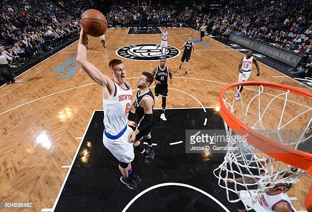 Kristaps Porzingis of the New York Knicks dunks the ball against the Brooklyn Nets on January 13 2015 at Barclays Center in Brooklyn New York NOTE TO...