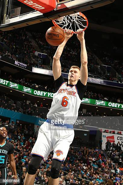 Kristaps Porzingis of the New York Knicks dunks the ball against the Charlotte Hornets during the game at the Time Warner Cable Arena on January 23...
