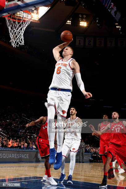 Kristaps Porzingis of the New York Knicks dunks the ball during the game against the Toronto Raptors on November 22 2017 at Madison Square Garden in...