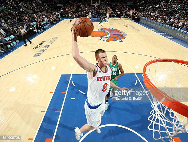 Kristaps Porzingis of the New York Knicks goes for a dunk against the Boston Celtics on October 15 2016 at Madison Square Garden in New York City New...