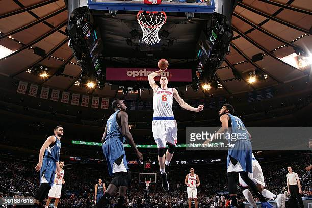 Kristaps Porzingis of the New York Knicks goes for the dunk during the game against the Minnesota Timberwolves on December 16 2015 at Madison Square...