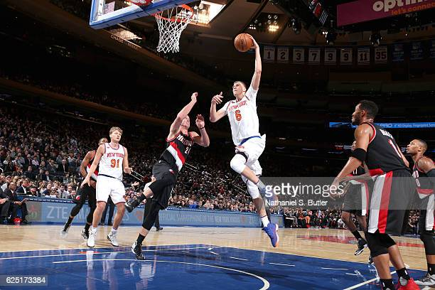 Kristaps Porzingis of the New York Knicks goes to the basket against the Portland Trail Blazers on November 22 2016 at Madison Square Garden in New...