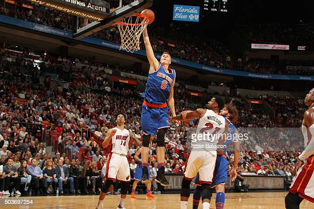 Kristaps Porzingis of the New York Knicks goes up for a dunk against the Miami Heat on January 6 2016 at American Airlines Arena in Miami Florida...