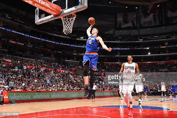 Kristaps Porzingis of the New York Knicks goes up for a dunk against the Los Angeles Clippers on March 11 2016 at STAPLES Center in Los Angeles...
