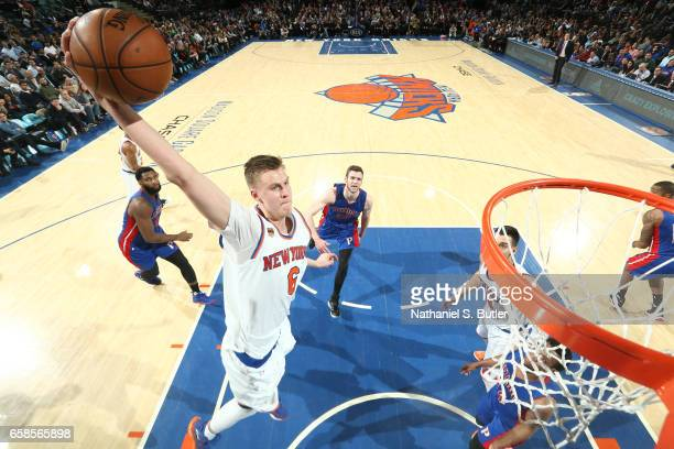 Kristaps Porzingis of the New York Knicks goes up for a dunk during a game against the Detroit Pistons on March 27 2017 at Madison Square Garden in...