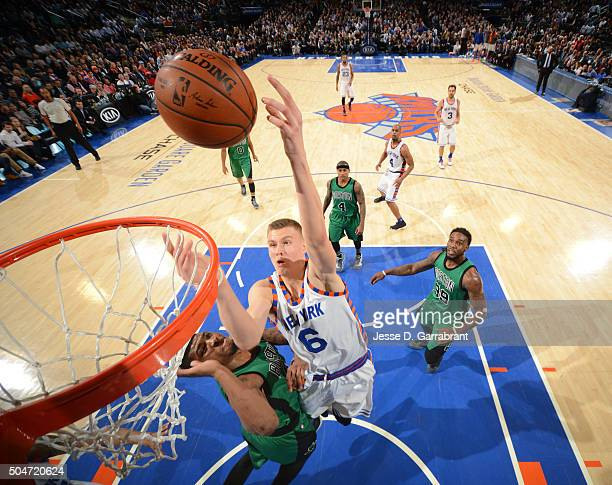 Kristaps Porzingis of the New York Knicks goes up for the layup against the Boston Celtics at Madison Square Garden on January 12 2016 in New YorkNew...