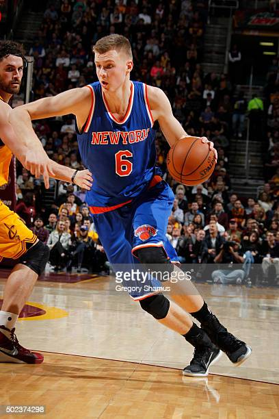 Kristaps Porzingis of the New York Knicks handles the ball against the Cleveland Cavaliers on December 23 2015 at Quicken Loans Arena in Cleveland...