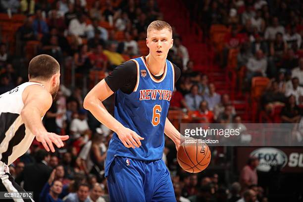 Kristaps Porzingis of the New York Knicks handles the ball against the Miami Heatl on December 6 2016 at American Airlines Arena in Miami Florida...