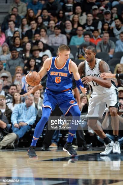 Kristaps Porzingis of the New York Knicks handles the ball against the San Antonio Spurs on December 28 2017 at the ATT Center in San Antonio Texas...