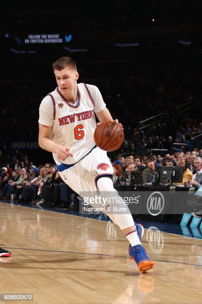 Kristaps Porzingis of the New York Knicks handles the ball during a game against the Detroit Pistons on March 27 2017 at Madison Square Garden in New...