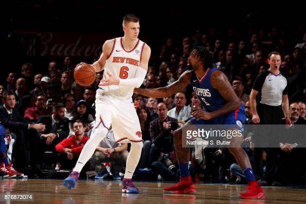 Kristaps Porzingis of the New York Knicks handles the ball during the game against the LA Clippers on November 20 2017 at Madison Square Garden in...