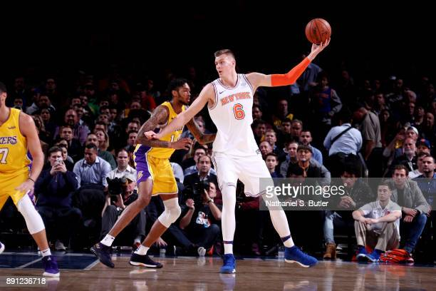Kristaps Porzingis of the New York Knicks handles the ball during the game against the Los Angeles Lakers on December 12 2017 at Madison Square...
