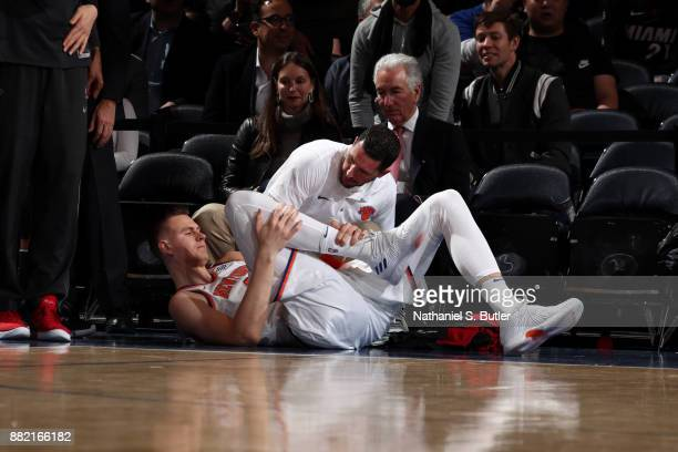 Kristaps Porzingis of the New York Knicks is injured during the 1st quarter of the game against the Miami Heat on November 29 2017 at Madison Square...