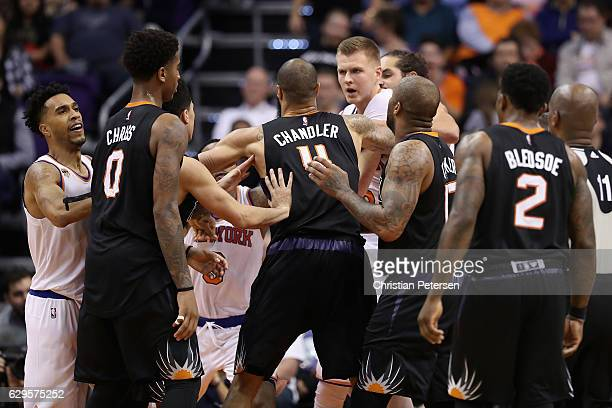 Kristaps Porzingis of the New York Knicks is restrained from Marquese Chriss of the Phoenix Suns after a confrontation during the second half of the...