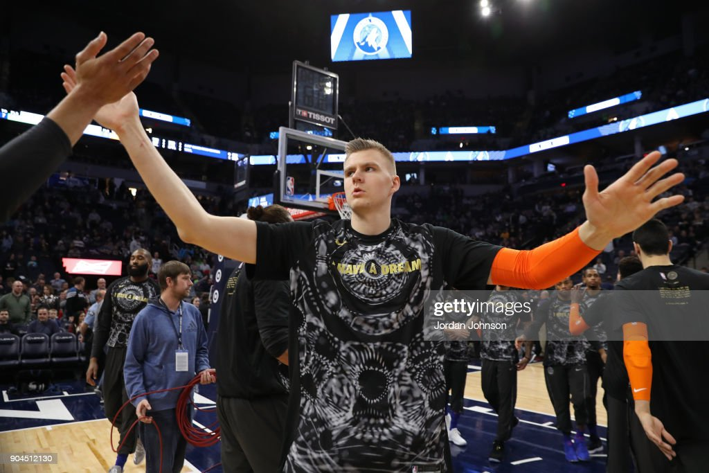 Kristaps Porzingis #6 of the New York Knicks runs out and high fives teammates before the game against the Minnesota Timberwolves on January 12, 2018 at Target Center in Minneapolis, Minnesota.