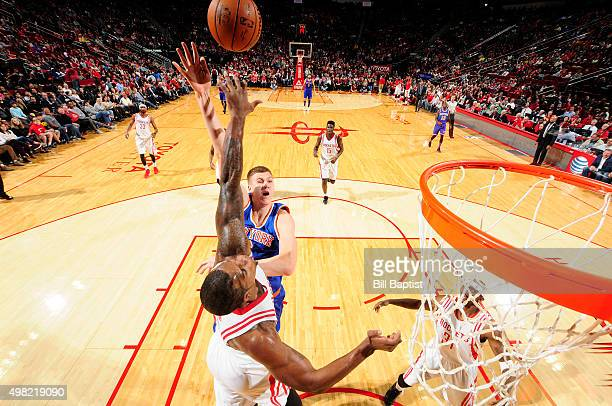 Kristaps Porzingis of the New York Knicks shoots the ball against the Houston Rockets on November 21 2015 at the Toyota Center in Houston Texas NOTE...