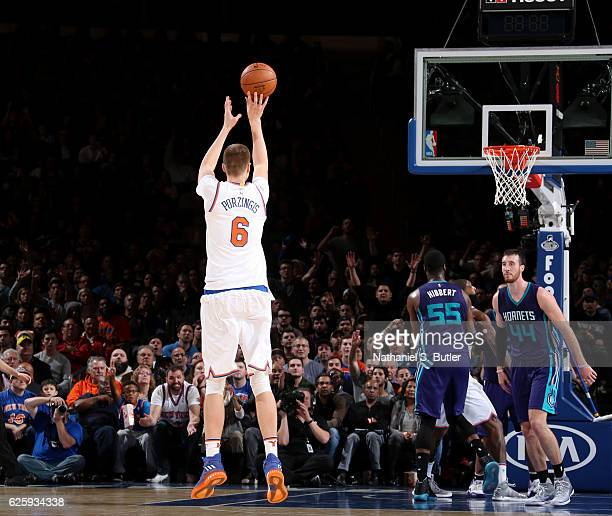 Kristaps Porzingis of the New York Knicks shoots the ball against the Charlotte Hornets at Madison Square Garden in New York New York NOTE TO USER...
