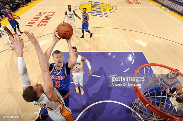 Kristaps Porzingis of the New York Knicks shoots the ball against the Los Angeles Lakers on December 11 2016 at STAPLES Center in Los Angeles...