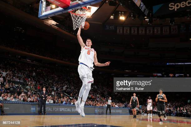 Kristaps Porzingis of the New York Knicks shoots the ball against the Brooklyn Nets on October 27 2017 at Madison Square Garden in New York City New...