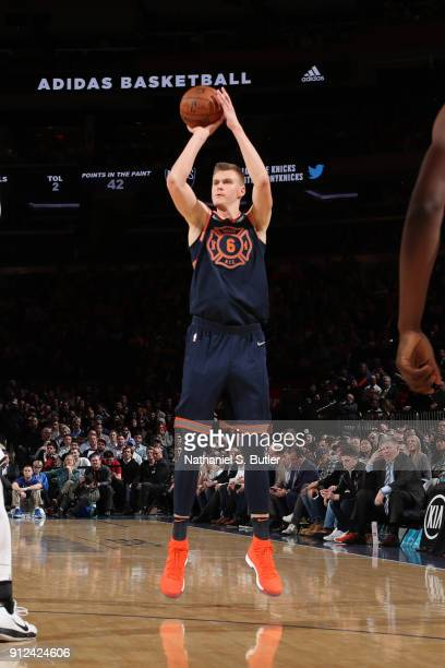 Kristaps Porzingis of the New York Knicks shoots the ball against the Brooklyn Nets on January 30 2018 at Madison Square Garden in New York City New...