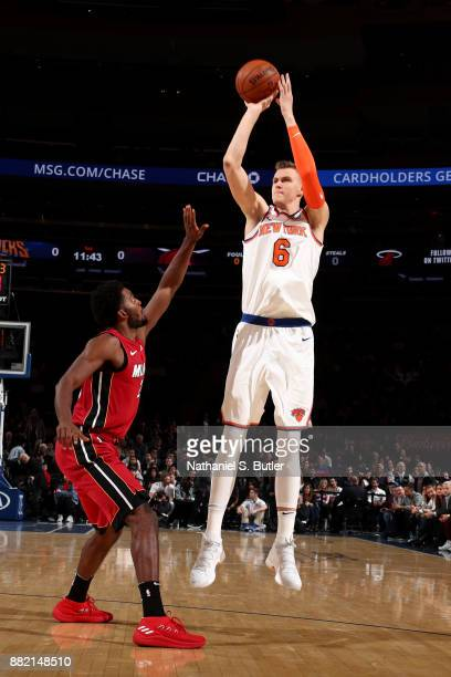 Kristaps Porzingis of the New York Knicks shoots the ball during the game against the Miami Heat on November 29 2017 at Madison Square Garden in New...